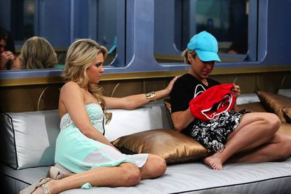 """Aaryn Gries, left, sits with GinaMarie Zimmerman, who is one of three finalists on CBS' """"Big Brother."""""""