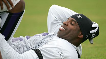 Cornerback Deion Sanders warms up during Ravens training camp in 2005 at McDaniel College in Westminster.