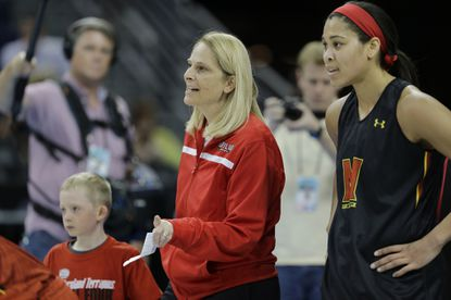 Maryland coach Brenda Frese and center Brionna Jones (Aberdeen) watch the team work out during a practice for last season's Final Four game.