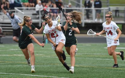 Century's Anna Hackett, left, and Caroline Little try to stop progress up the field by Glenelg's Isa Torres during a girls lacrosse game at Glenelg High School on Friday, June 11, 2021.