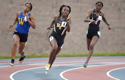 Harford Tech's Caitlyn Bobb cruises around the turn of the track, running in the 2A girls 200 meter preliminary race in 2019. Bobb went on to win the state title and three others during the state track meet at Morgan State University.