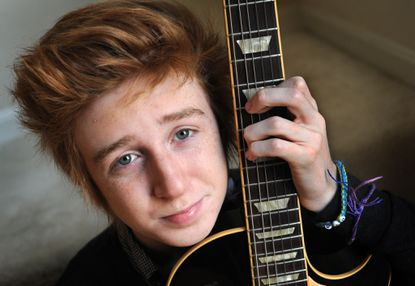 Dan Geraghty, 17, is a member of a band called Hollywood Ending that is competing for a recording contract in a Radio Disney contest called The Next Big Thing. He's pictured at home with his electric guitar.