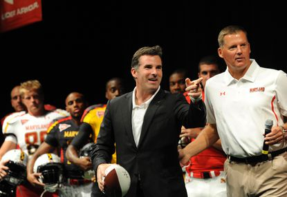 Kevin Plank, the chief executive officer of Under Armour talks with Maryland head football coach Randy Edsall during a uniform reveal for the Maryland football team in 2011.