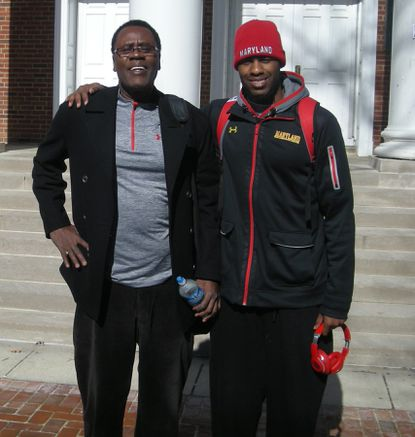 Ernie and Jon Graham pose outside Tydings Hall on the campus of the University of Maryland on Tuesday afternoon.