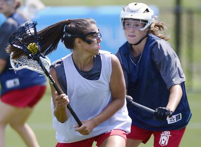 Emily Messinese, left, of Gerstell Academy, works against Ashley Moynahan, of Fairfield Ludlowe (Conn.), while participating in a National Team Development Program combine at US Lacrosse.