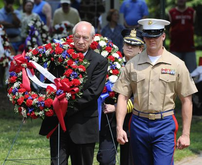 Havre de Grace mayor Wayne Dougherty walks with Sgt. Christopher C. Ahrens to put a wreath at the memorial in Tydings Park during the Havre de Grace Memorial Day ceremony.