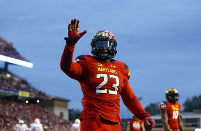 Maryland linebacker Jermaine Carter Jr. waits to high-five a teammate in the first half of an NCAA college football game against Wisconsin, Saturday, Nov. 7, 2015, in College Park.