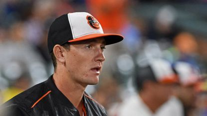 Outfielder Austin Hays watches the Orioles-Yankees game from the dugout after he was called up from the Bowie Baysox. He will try to make the Orioles roster out of spring training this season.