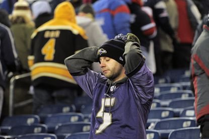 Ravens fan Machis Priess, who flew in from Copenhagen, Denmark, to see the Ravens, reacts to a stunning loss.