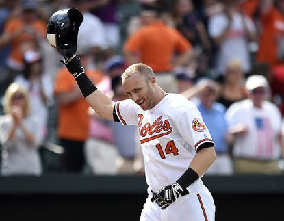 The Baltimore Orioles' Nolan Reimold tips his helmet after hitting a walk-off, two-run home run against the Cleveland Indians Sunday at Camden Yards.
