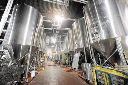 "A view of ""fermenter alley"" shows some of the brewing tanks at Clipper City Brewing on Hollins Ferry Road. The craft brewery has been in operation at the location since December 1995."