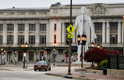 Penn Station was built in 1911 on the site of two previous train stations in the geographic center of Baltimore.