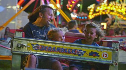 "Mike Chubb of Glen Burnie rides the ""Scrambler"" with his boys, Jacob, 6, center, and Braeden, 8 at the 2015 Big Glen Burnie Carnival."