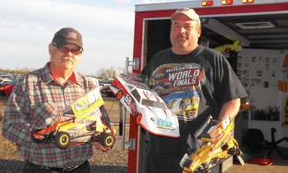 Terry Turnbaugh, left, and Kayo Clark hold their remote controlled_race cars outside the racing trailer they share at Staub Brothers RC Speedway in Bonneauville, _Pa. __- Original Credit: Photo by Lois Szymanski