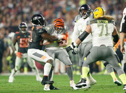 Ravens linebacker Elvis Dumervil sacks the Bengals' Andy Dalton during Sunday night's Pro Bowl.