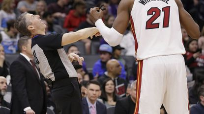 Referee Scott Foster demonstrates to Miami Heat center Hassan Whiteside why he called a foul on Whiteside during the second half of an NBA basketball game against the Sacramento Kings Friday, Feb. 8, 2019, in Sacramento, Calif.