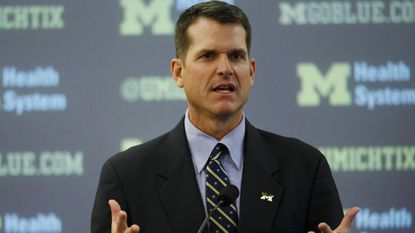 John Harbaugh says Jim Harbaugh's Michigan news conference 'was fantastic'