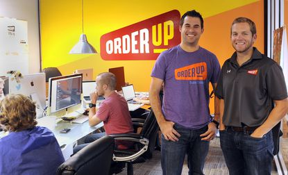 Baltimore, MD -- Jason Kwicien, left, chief operating offier and Chris Jeffery, right, CEO at OrderUp, stand in the company's engineering area. OrderUp is a startup online company that delivers food for restaurants that do not themselves offer takeout service.