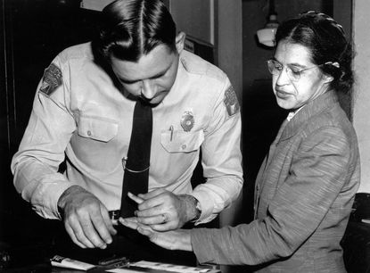 Rosa Parks is fingerprinted by police Lt. D.H. Lackey in Montgomery, Ala., in this Feb. 22, 1956 file photo, two months after refusing to give up her seat on a bus for a white passenger on Dec. 1, 1955.
