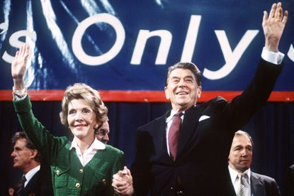 President Ronald Reagan and his wife Nancy wave to supporters at a voter rally in early November 1984, a few days before the presidential election he won in a landslide. File.