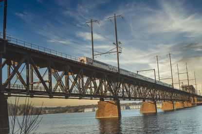 A landscape photo shot by Kendrick Sumpter shows an Amtrak train crossing the Susquehanna River.