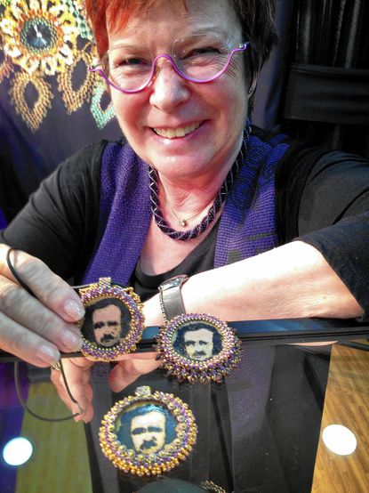 Bead designer Thea Fine with Edgar Allan Poe pendants at the American Craft Council Show Saturday at the Baltimore Convention Center.