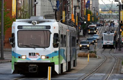 A north bound MTA light rail train travels up Howard Street at Mulberry in Downtown Baltimore.