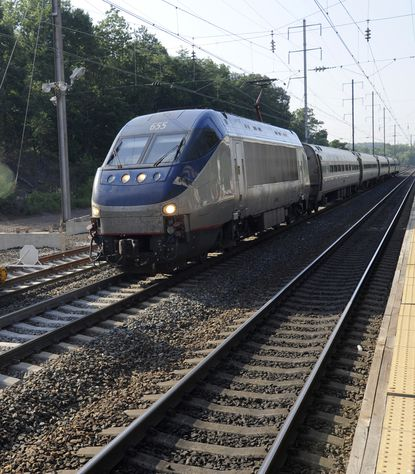 An Amtrak train passes through the BWI station.