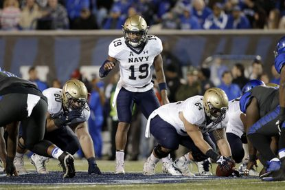 Navy quarterback Keenan Reynolds  calls a play in the first half of a game against Memphison Nov. 7, 2015, in Memphis, Tenn.