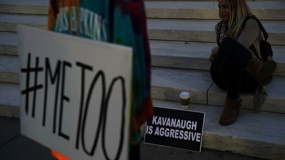 A protester on the steps of the Supreme Court Friday night in Washington.