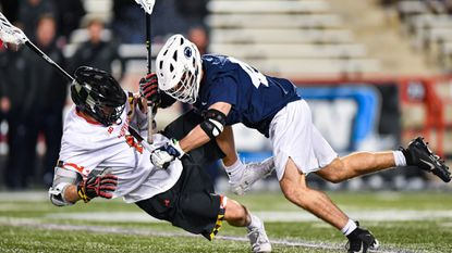 Maryland's Logan Wisnauskas is leveled by a crushing check from Penn State defender Nick Cardile during the regular season. Penn State's pressure defense has helped it earn the top seed in the NCAA men's lacrosse tournament.