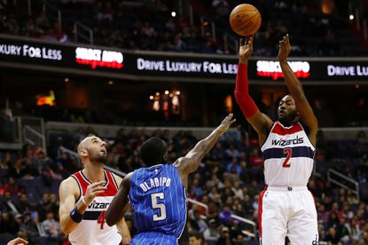 John Wall (2) and the Wizards will open their season against Victor Oladipo (5) and the Magic.