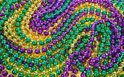 To make use of the infamous Mardi Gras beads, fill vases, fishbowls and even top hats. Encourage guests to help themselves. (Dreamstime) ** OUTS - ELSENT, FPG, TCN - OUTS **