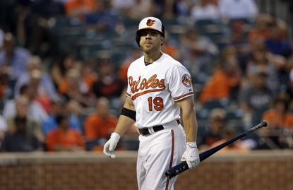 Baltimore Orioles' Chris Davis walks off the field after striking out during a baseball game against the Houston Astros, Tuesday, May 26, 2015, in Baltimore.