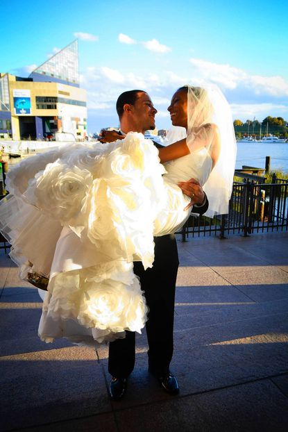 Joey whisks his bride away outside of the World Trade Center at the Inner Harbor.