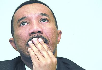 Kweisi Mfume, the first black Democratic candidate to run for U.S. Senate in Maryland, ponders a question during an interview session Friday, March 25, 2005, in Baltimore. (AP Photo/Chris Gardner)