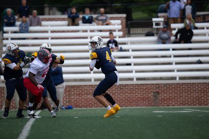 St. Paul's quarterback Scott Smith III (#4) is headed to play football for the Towson Tigers.