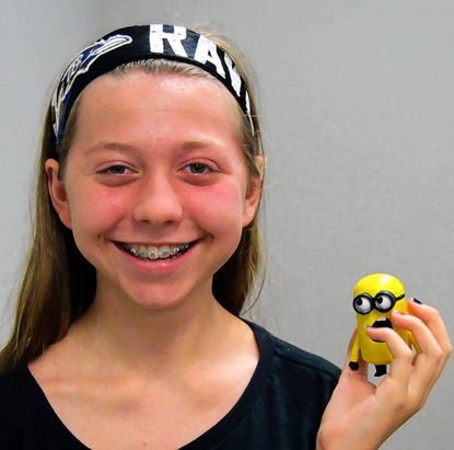 Jeneanne Mittman shows off the minion she made using the Abingdon Library's 3D printer.