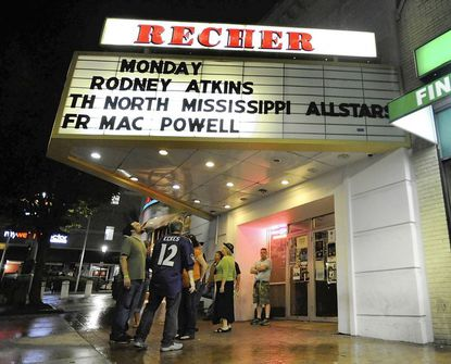 Patrons stand outside Recher Theatre in Towson.