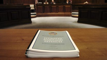 A copy of the estimated Maryland revenue report sits atop a table Dec. 16, 2008, before the start of a Board of Revenue Estimates meeting in Annapolis.