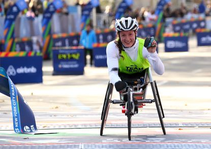 of the United States crosses the finish line to win the Pro Women's Wheelchair during the 2016 New York City Marathon in Central Park on November 6, 2016 in New York City.
