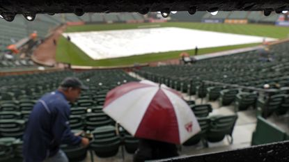 Fans choose to vacate the seating bowl as rain falls during a rain delay, stopping play between the Baltimore Orioles and the Seattle Mariners at Oriole Park at Camden Yards on May 21, 2015.