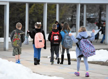 Students made their way into Forest Lakes Elementary School Monday morning to begin their day after a week long break because of last week's blizzard.