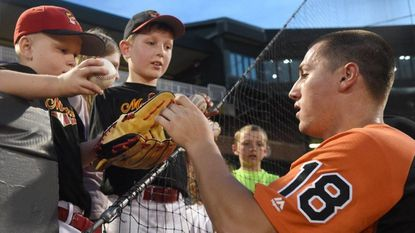 Aberdeen IronBirds player Doran Turchin, shown here signing a few autographs recently, had the big hit for Aberdeen in Thursday night's win in Brooklyn, NY.