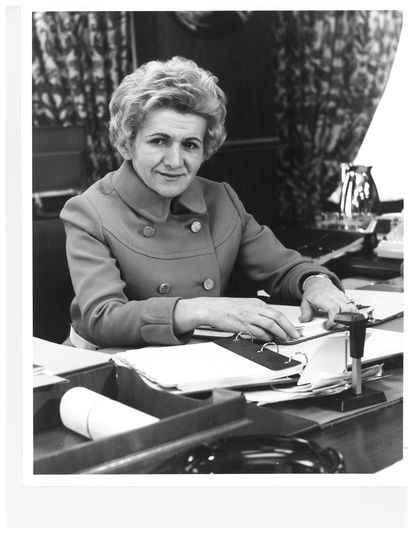 Helen Delich Bentley at her desk at the Maritime Commission, wearing a red sleeveless wool dress with matching double-breasted jacket, from around 1969 with a Jeannette Beck Baltimore/New York label (also labeled Barberini).