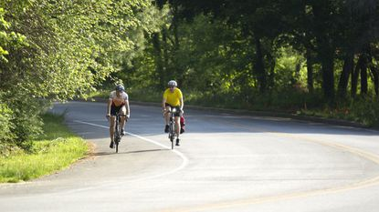 Cyclists Aaron Fields, of Columbia, and Fran Horan, right, of Ellicott City, ride along Martin Road while biking to work in Columbia. The BikeHoward Express initiative is the county's first major implementation of its bike master plan.
