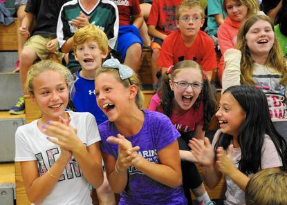 Fountain Green Elementary School fifth graders, from left, Maja Mroz, Hannah Silcox, Sarah Jump and Nick Simons, back left, and Erin Acerno, back right, celebrate with their classmates and the rest of the schoool after hearing the announcement that the school was named as a National Blue Ribbon School for 2015 during an assembly Tuesday afternoon.