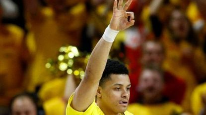 Maryland guard Anthony Cowan Jr. gestures after making a three-point basket in the first half against Minnesota Friday.