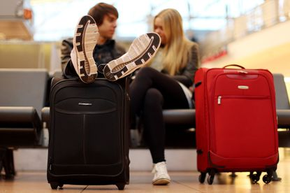A carry-on can hold all the clothes you need for a month.