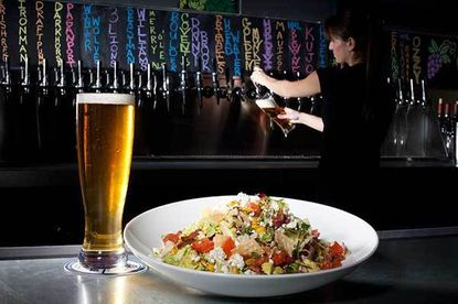 The Ale House in Columbia offers more than 50 craft beers, including their own brand, Oliver Breweries. The chop salad here is paired with Oliver's blonde ale.